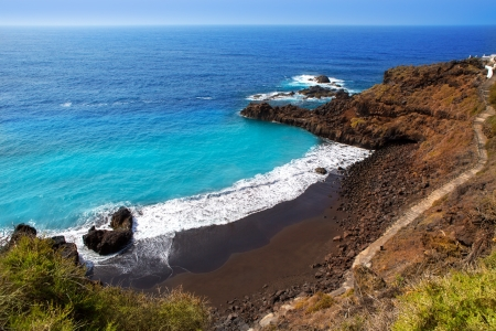 briny: Beach el Bollullo black brown sand and aqua water near Puerto de la Cruz