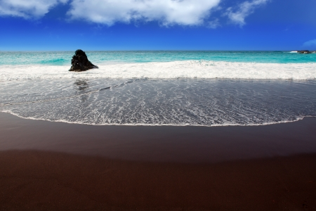 canarian: Beach el Bollullo black brown sand and aqua water near Puerto de la Cruz