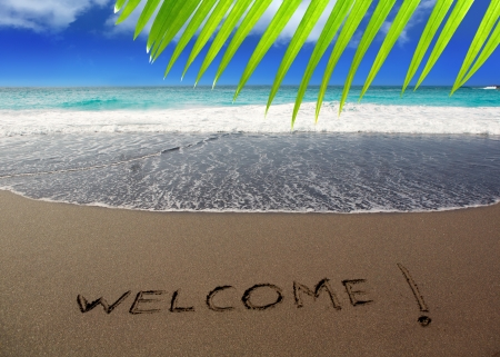 canary island: Brown sand beach with written word Welcome in Canary Islands