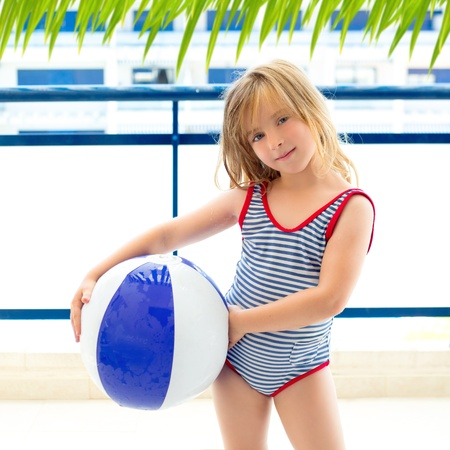 bathing costume: Blond kid girl with swimsuit with summer blue ball in balconade