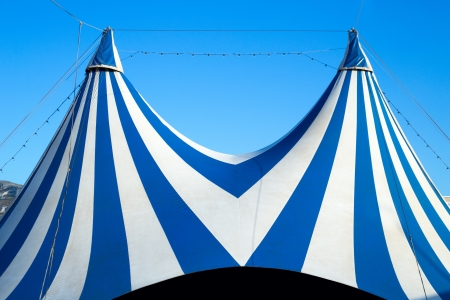 Circus tent stripped blue and white over clear sky photo
