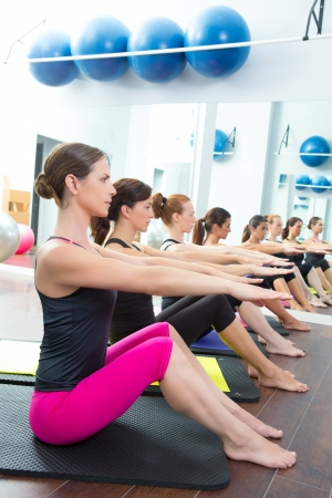aerobic training: Aerobic Pilates personal trainer in a gym group class in a row