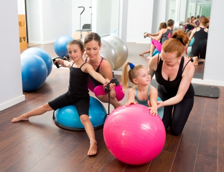 Aerobics pilates women kid girls personal trainer instructors at gym Stock Photo - 15429293