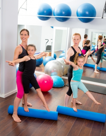 limber: Aerobics pilates women kid girls personal trainer instructors at gym Stock Photo