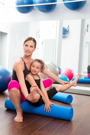 ball stretching: Aerobics woman personal trainer of children girl stability with foam roller