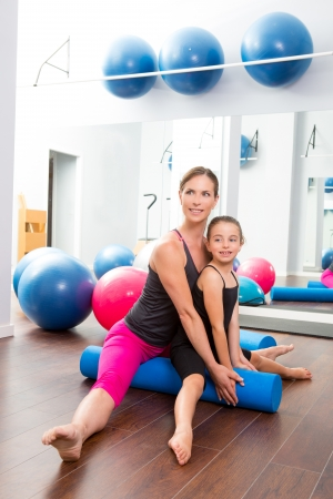 fit ball: Aerobics woman personal trainer of children girl stability with foam roller