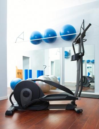 elliptic: Aerobics cardio training elliptic crosstrainer bicycle device at gym