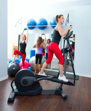 Aerobics cardio training woman on elliptic crosstrainer bicycle at gym Stock Photo - 15429313