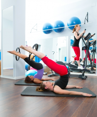 limber: Aerobics pilates women with magic ring and crosstrainer
