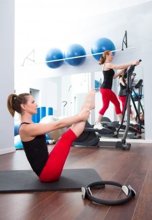 Aerobics pilates gym women group with crosstrainer Stock Photo - 15429323