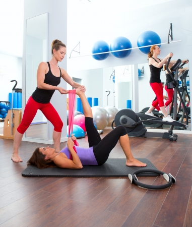 Aerobics pilates gym women personal trainer with ribber band Stock Photo - 15429315