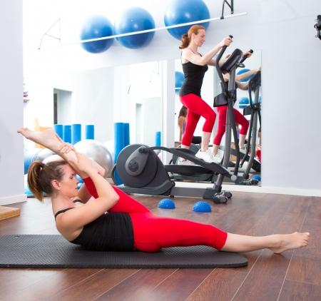 toning: Aerobics pilates gym women group with crosstrainer