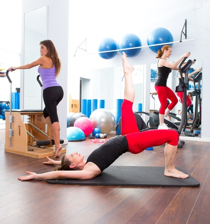 Aerobics pilates gym women group with crosstrainer Stock Photo - 15429311