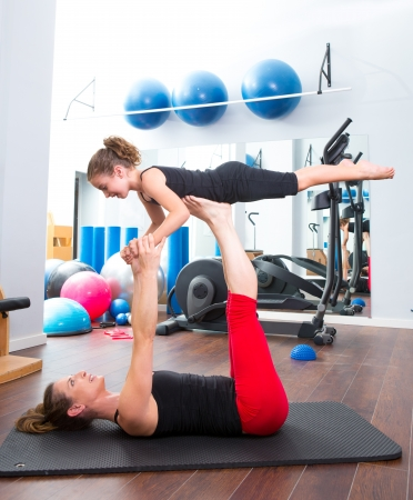 Aerobics woman personal trainer of children girl stability balance photo