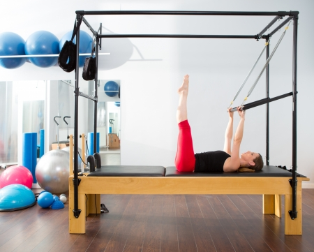 Pilates aerobic instructor woman in cadillac fitness exercise Stock Photo - 15429330