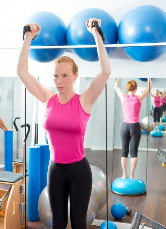 Bosu ball for fitness redhead woman in aerobics gym photo