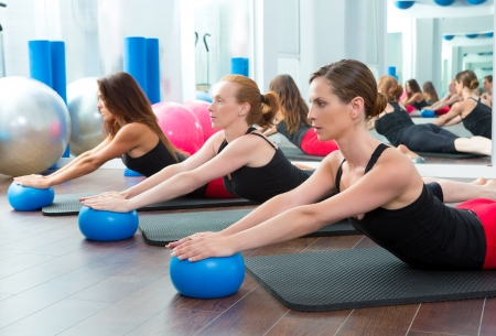 body toning: Aerobics pilates women with yoga balls in a row on fitness class Stock Photo
