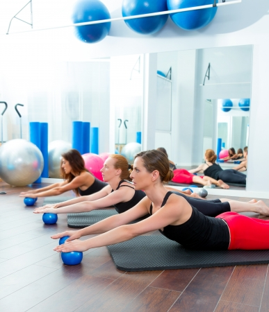 toning: Aerobics pilates women with toning balls in a row on fitness class Stock Photo