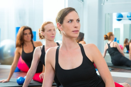 Beautiful women group in a row at aerobics gym class  Stock Photo - 15444288