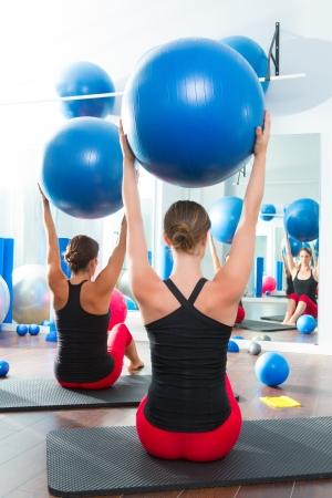 Blue stability ball in women Pilates class rear mirror view Stock Photo - 15444261