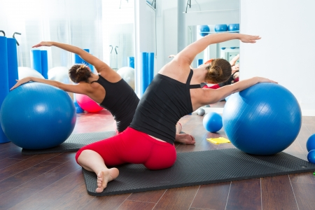 Blue stability ball in women Pilates class rear mirror view photo