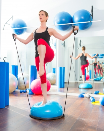 rubber bands: Bosu ball for fitness instructor woman in aerobics gym Stock Photo