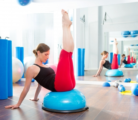 physical training: Bosu ball for fitness instructor woman in aerobics gym Stock Photo