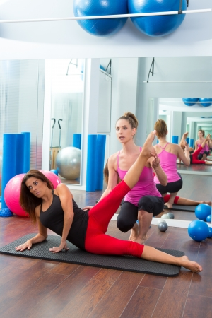 Aerobic Pilates personal trainer instructor in women gym fitness class Stock Photo - 20130186