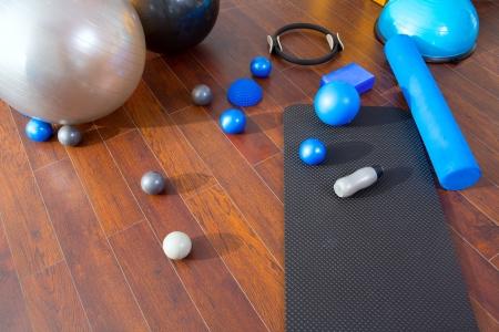 leisure equipment: Aerobic Pilates stuff like mat balls roller magic ring rubber bands on wooden floor