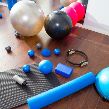 Aerobic Pilates stuff like mat balls roller magic ring rubber bands on wooden floor Stock Photo - 15440328