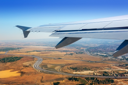 barajas:  Airplane takeoff from Madrid Barajas over golden wheat fields Stock Photo