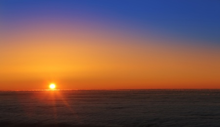 nightfall: La Palma sunset over sea of clouds in Roque Muchachos Canary Islands