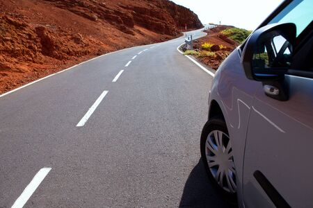 Canary Islands winding road curves and car driving photo