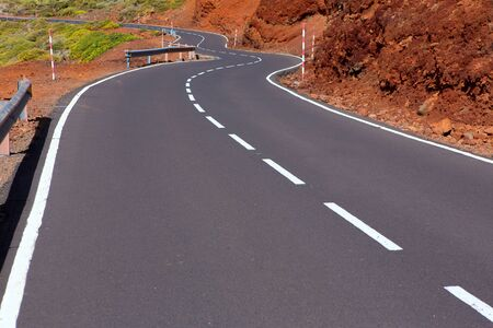 Canary Islands winding road curves in red mountain photo