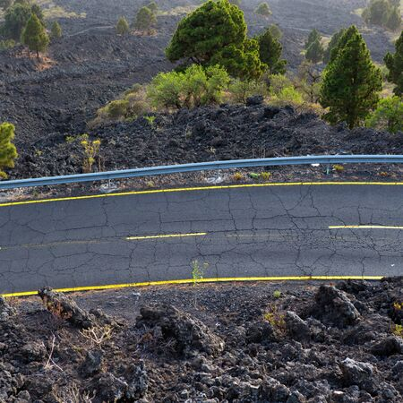 backstop: La Palma road detail in volcanic lava landscape at Canary Islands Stock Photo