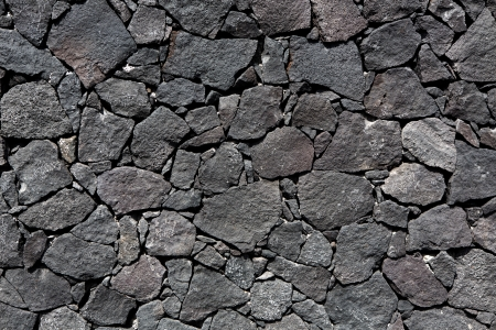 stone volcanic stones: Black lava stone volcanic masonry wall in Canary Islands