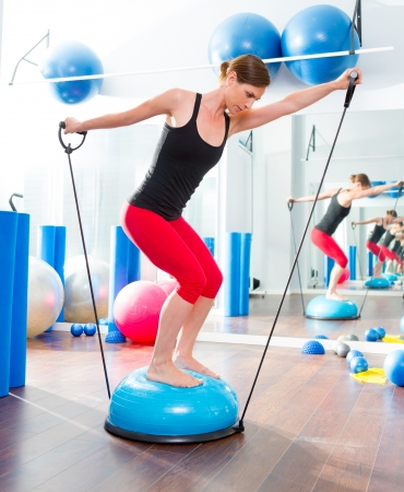 elastic: Bosu ball for fitness instructor woman in aerobics gym Stock Photo