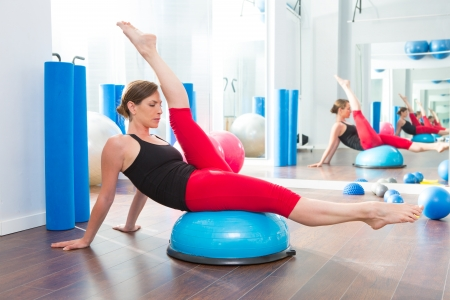 Bosu ball for fitness instructor woman in aerobics gym photo