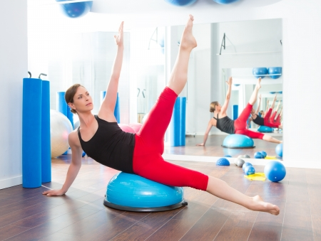 limber: Bosu ball for fitness instructor woman in aerobics gym Stock Photo