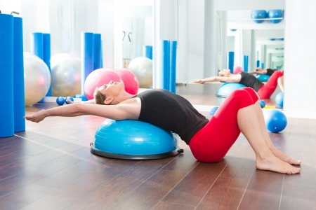 Bosu ball for fitness instructor woman in aerobics gym Stock Photo