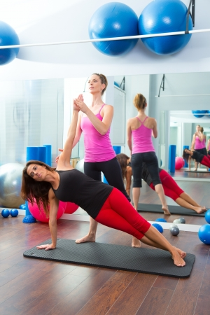 Aerobic Pilates personal trainer instructor in women gym fitness class photo