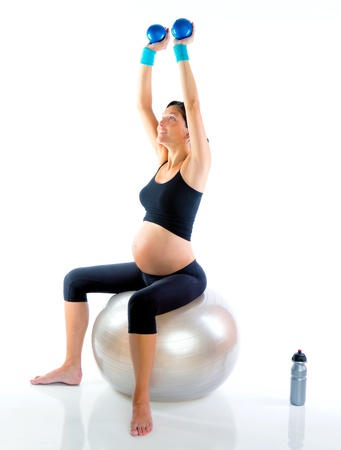 toning: Beautiful pregnant woman at fitness gym with toning balls on aerobics Stock Photo