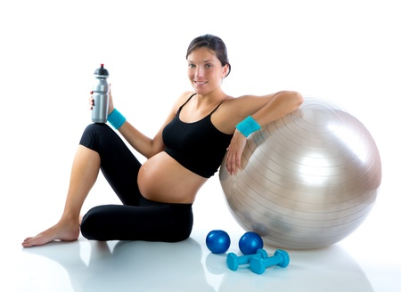 pregnant woman yoga: Beautiful pregnant woman at fitness gym relaxed with aerobics ball
