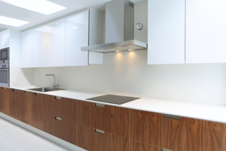 kitchen bench: Actual modern kitchen in white and walnut wood interior house Stock Photo