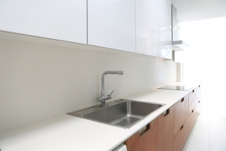 Actual modern kitchen in white and walnut wood inter house Stock Photo - 15901422