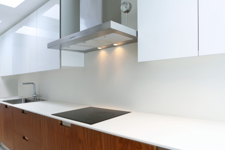 actual: Actual modern kitchen in white and walnut wood interior house Stock Photo