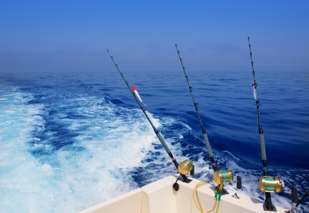 trolling: boat fishing trolling in deep blue ocean offshore in Mediterranean sea