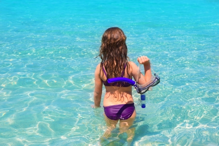 aqua beach in ibiza formentera rear kid girl view with snorkel Stock Photo - 15909068