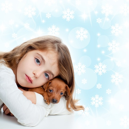 christmas snowflakes with children girl hugging a puppy brown dog Stock Photo - 15903149