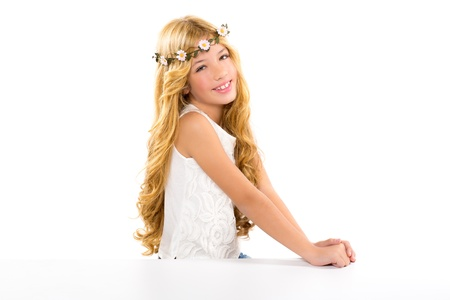 children blond girl with spring daisy flowers crown smiling on white photo